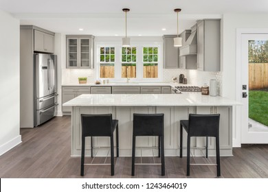 Beautiful Kitchen in Newly Built Residential Home, with Stainless Steel Appliances