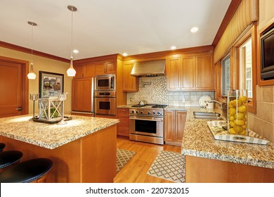 Beautiful kitchen storage combination with granite tops and modern steel stainless appliances
