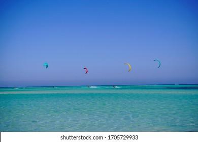 Beautiful Kitesurfers riding by a beautiful Tawilla Island, Red Sea - Kitesurfing in Egypt 01