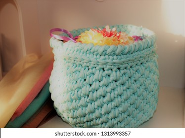 Beautiful knitted blue basket for different little things in the style of Shabby Chic.