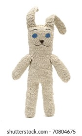 Beautiful knitted toy rabbit. Old hand-made souvenirs