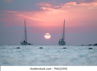 Beautiful Koh Lipe Island Sunset, in Thailand! Lonely boats, white sand beaches as the sun goes down! Paradise Island