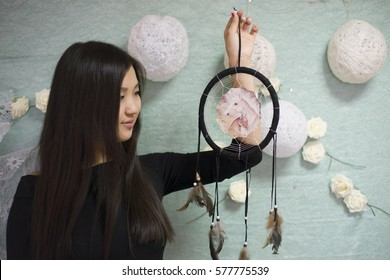 Beautiful Korean the girl holding a dream catcher. It is needed in order to catch bad dreams.