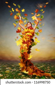 Beautiful lady Autumn in the dress from yellow maple leaves