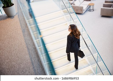 Beautiful lady with bag walking up the stairs stock photo