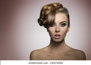 beautiful lady with creative elegant hair-style and fashion make-up in close-up portrait