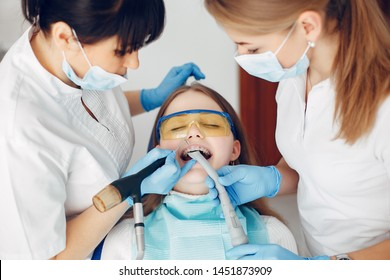 Beautiful lady in the dentist's office. Woman in a uniform