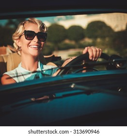 Beautiful lady driver in a  classic convertible