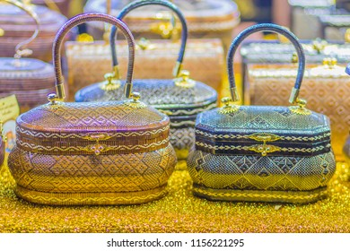 """Beautiful lady handbags and basketry that made from Lygodium (climbing fern), or """"Yan lipao"""" in Thai, the famous product from Southern Thailand for sale at night market, Bangkok. Selective focus"""