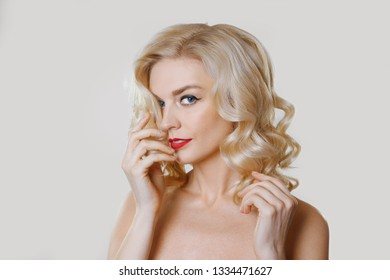 Beautiful lady with healthy skin, natural makeup and red lips