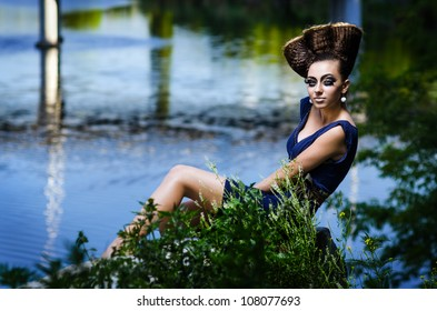 Beautiful lady with an improbable hairdress