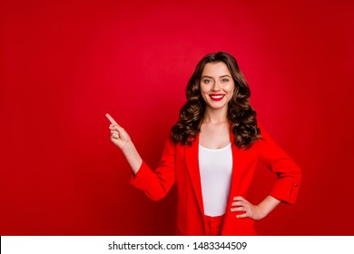 Beautiful lady indicating empty space on black friday prices dressed formal-wear costume isolated burgundy background