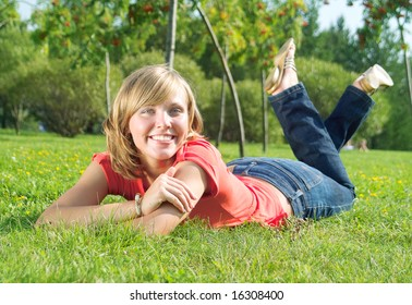 A beautiful lady lay on the grass in sunny day