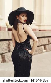 Beautiful lady in luxury dress on street
