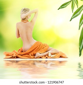 beautiful lady with orange towels on sand