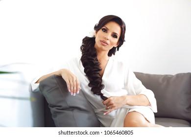 Beautiful lady posing in white robe