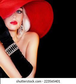 beautiful lady in red hat looking at camera