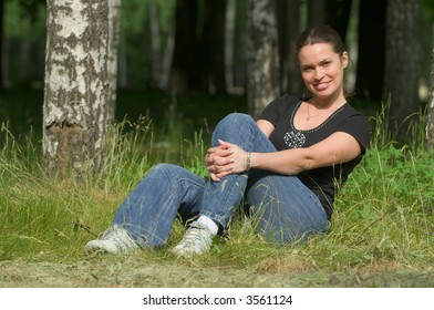 Beautiful lady relaxing outdoors in a park