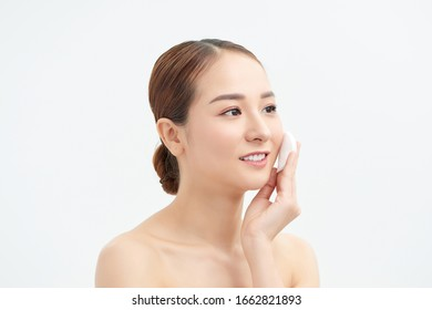 Beautiful lady removing makeup from her face, skin care concept / photoset of attractive brunette girl on white background