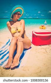 Beautiful lady resting alone on a beach.