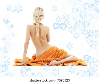 beautiful lady in spa with orange towels and snowflakes