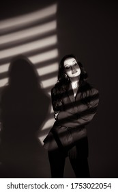 Beautiful lady in the spotlight. Fashion art photo. Blackwhite