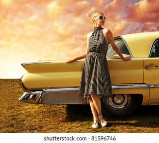 Beautiful lady standing near retro car.