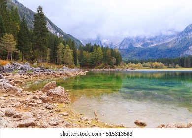 Beautiful Lago di Fusine the mountain lake and Mangart mountain in the background in north Italy in Alps, Europe