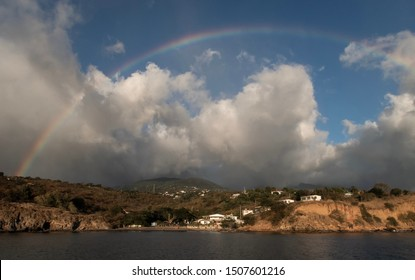 Beautiful lagune with mounting and sky with clouds. Guadalupe island bay. Caribbean lagune from the water
