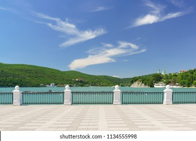 Beautiful lake Abrau in the Caucasus mountains on a clear Sunny summer day. Embankment. Bright landscape