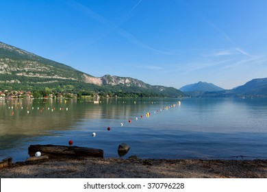 Beautiful lake Annecy surrounded by mountains