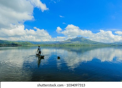 Beautiful Lake Batur landscape overlooking serene and beautiful Mount Batur during blue sky cloudy day