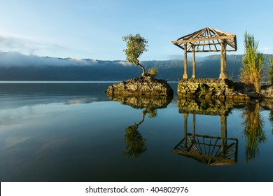 Beautiful Lake Batur landscape overlooking serene and beautiful Mount Batur during blue sky cloudy day, Bali Indonesia.