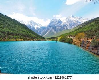 Beautiful lake at Blue Moon Valley with background of Jade dragon snow mountain in Lijiang, Yunnan, China.