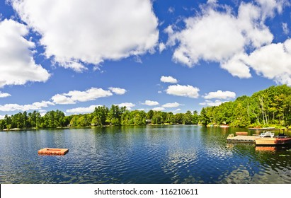 Beautiful lake with dock and diving platform in Ontario Canada cottage country