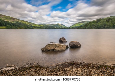Beautiful Lake Grasmere landscape from the Lake District in the UK.  Long exposure used so water is smooth.