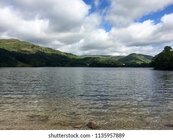 Beautiful lake landscape with dramatic cloudscape taken at Lake Grasmere in the Lake District, UK