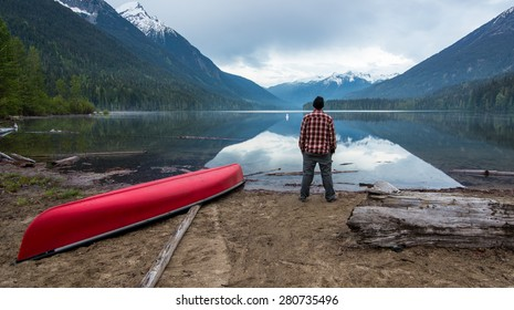 Beautiful lake with man standing on the shore