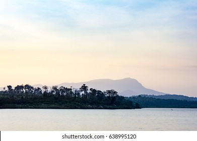 Beautiful lake and mountain on the background at the sunset time landscape in Cardamom Mountains, Cambodia