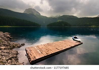 A beautiful lake in the mountains. Black Lake, Durmitor, Montenegro.
