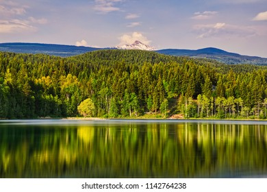 A beautiful lake near Clearwater. Nice reflection of trees and mountain in the background. Nature at his best!!