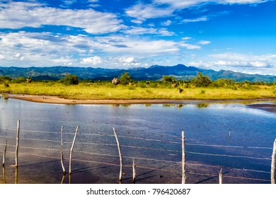 Beautiful lake near Trinidad, Cuba on a sunny afternoon. Mountains and forest in the background.