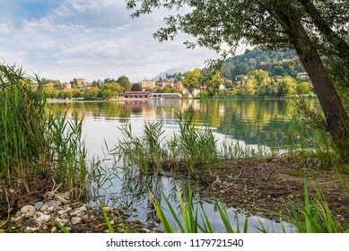 Beautiful lake in northern Italy. Lake Varese, in the background the town of Gavirate with its lake promenade. Lake famous because it hosts rowing competitions of national, European and world level