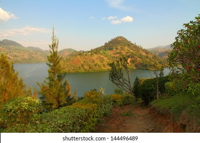 A beautiful lake and scenic hills scene from a garden path