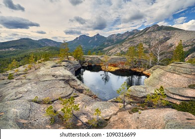 Beautiful Lake in shape of heart in mountains of Karkaraly national park in Central Kazakhstan