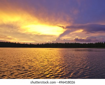 Beautiful lake sunset in Lapland. Natural background.