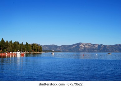 Beautiful Lake Tahoe on a clear blue day surrounded by pines and mountains