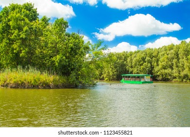 Beautiful lake and tourist boat in nature park Kopacki rit in Slavonia, Croatia, popular tourist destination and birds reservation