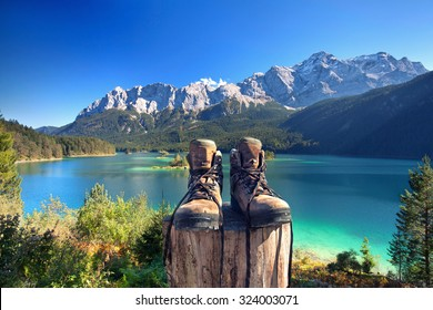 beautiful lake view to eibsee and Zugspitze with hiking boots