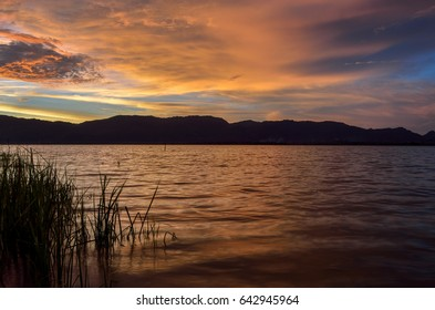 Beautiful lake view on sunset. With water, mountain and cloud